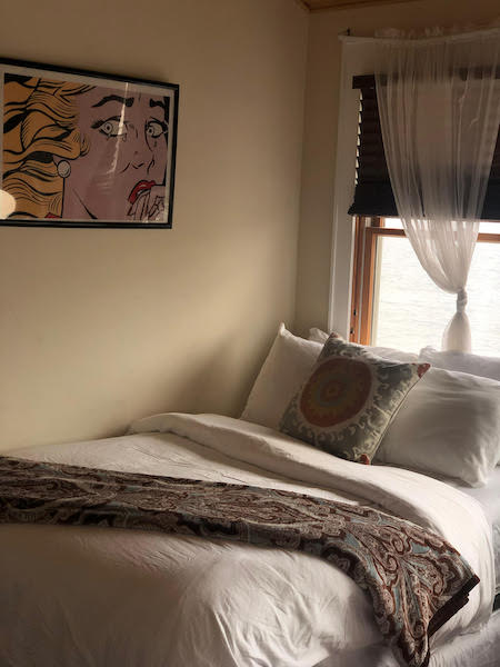 bedroom full bed with comic book style art on wall