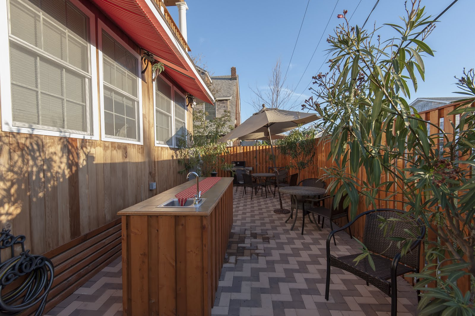 Bungalows private courtyard ,wraps around the back of the building. BBQ grills on site for guest use, outdoor showers, ice machine.