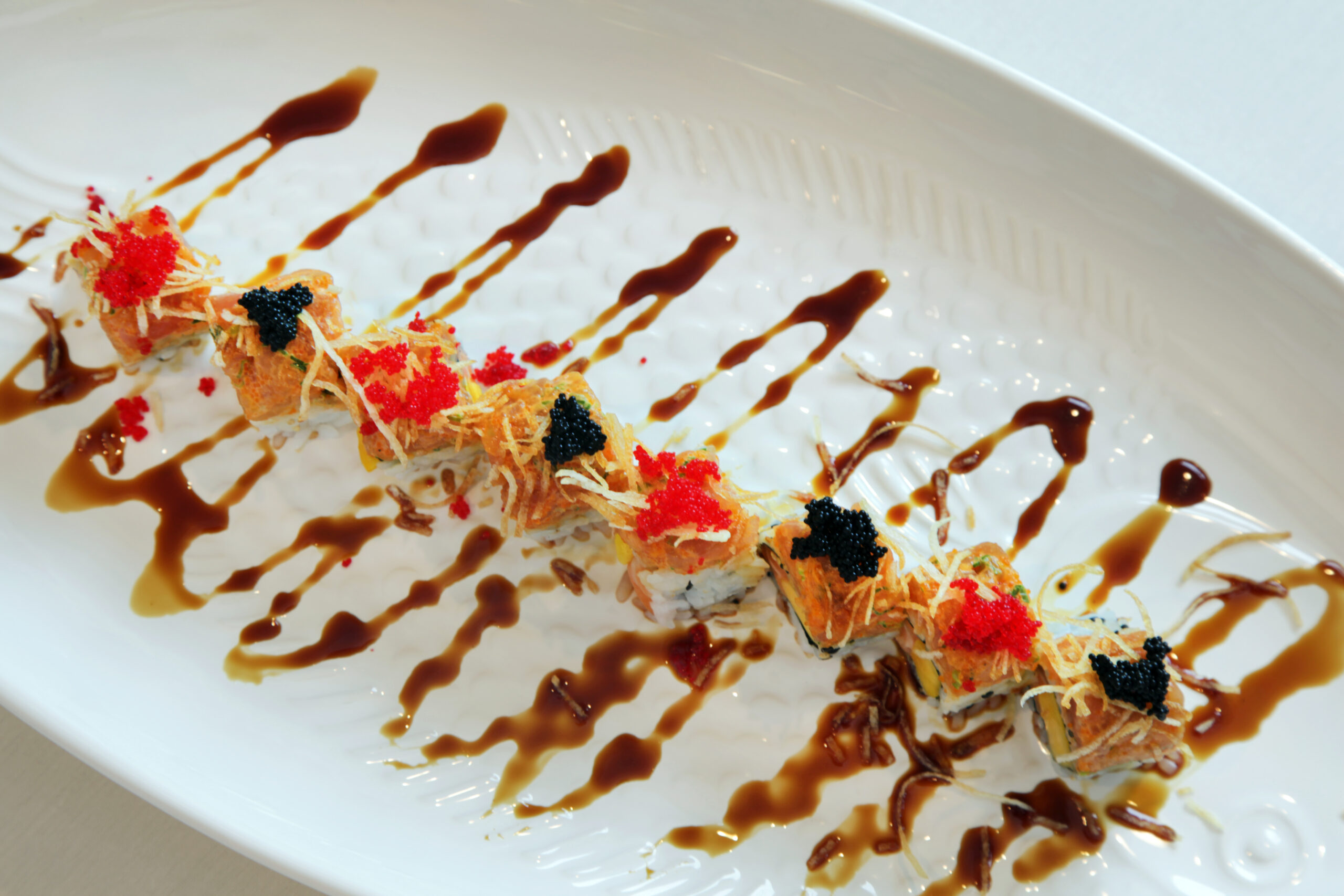 Featured Roll: RICO ROLL <br>topped with spicy tuna and caviar