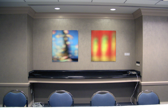 2 abstract photographs hanging on wall of meeting space
