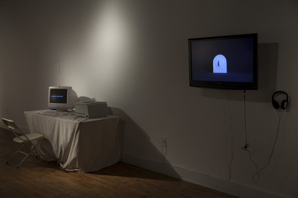 empty gallery full of art, video of timer, old computer