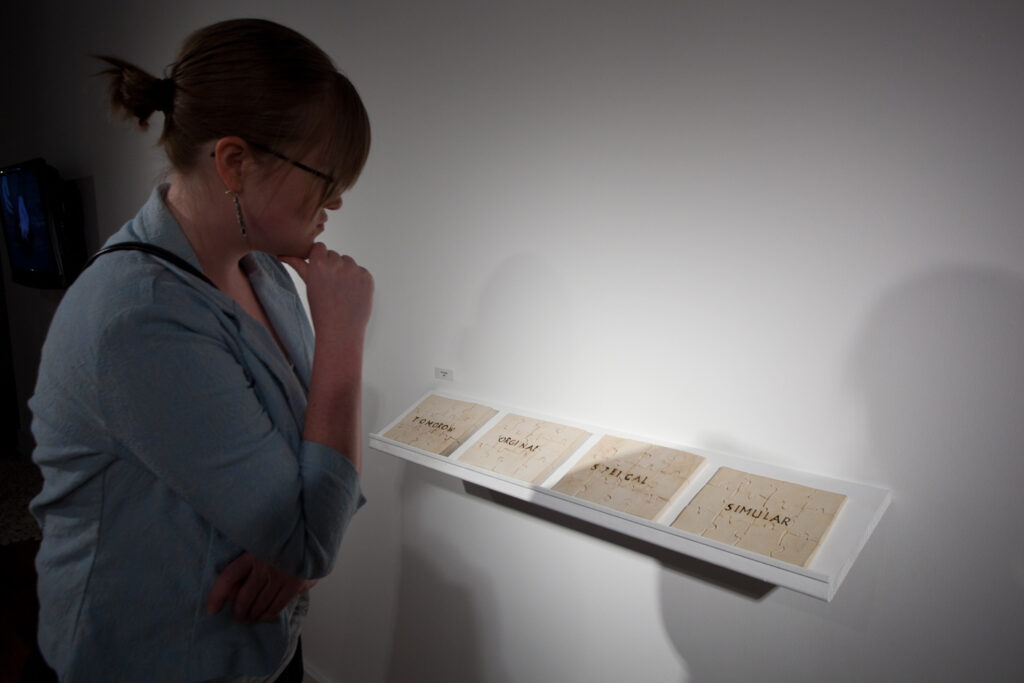 woman looking at four puzzles with text on each puzzle