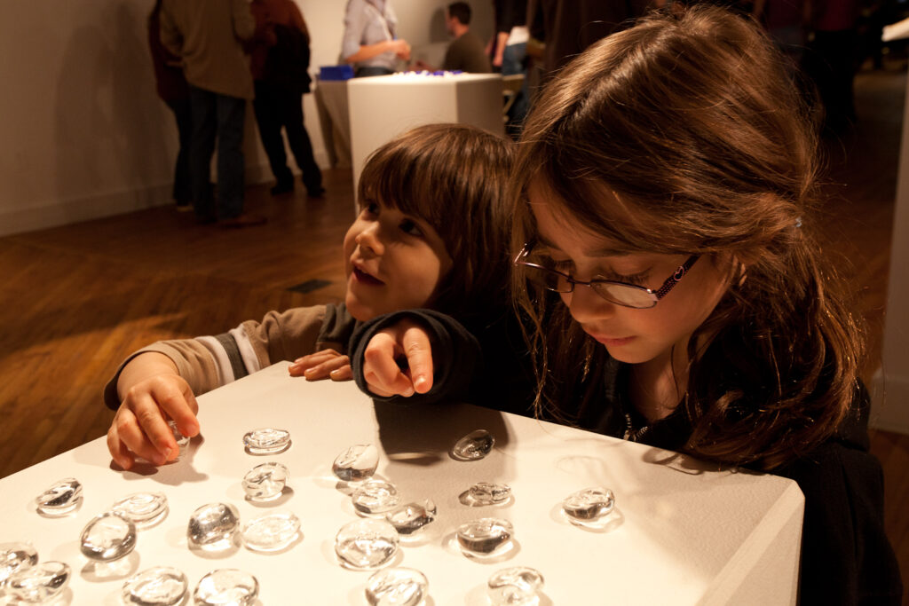 boy and girl looking at glass letters