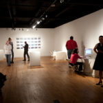 Gallery full of people at opening night