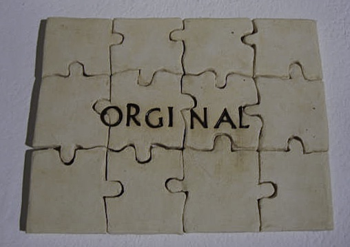 ceramic puzzle complete with the word ORGINAL