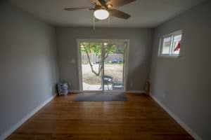 Mater bed addition with new hardwood flooring and 6 foot sliding door