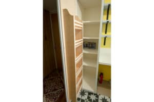 8 foot tall pantry door with shelf inside as well as custom wood shelf on the back of the door.