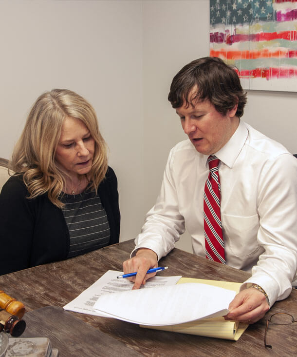 An image of Attorney Austin Buerlein consulting with a client in the EO family law office.