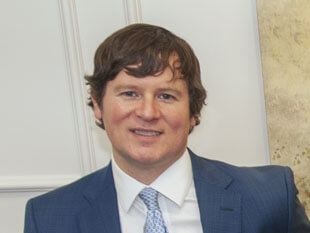 An image of attorney Austin Buerlein in the EO Family Law Office that links to Mr Buerlein  profile.