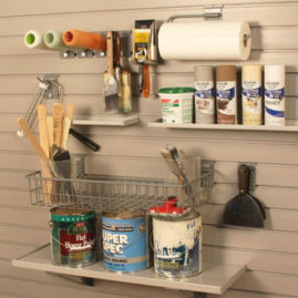 Paint Supplies organized on slatwall panels