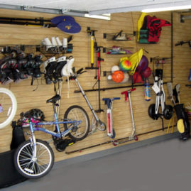 Sports equipment organized on slatwall panels