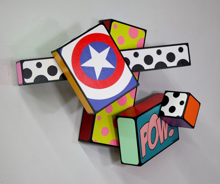 pop culture style patterns and imagery on 3 d blocks on wall