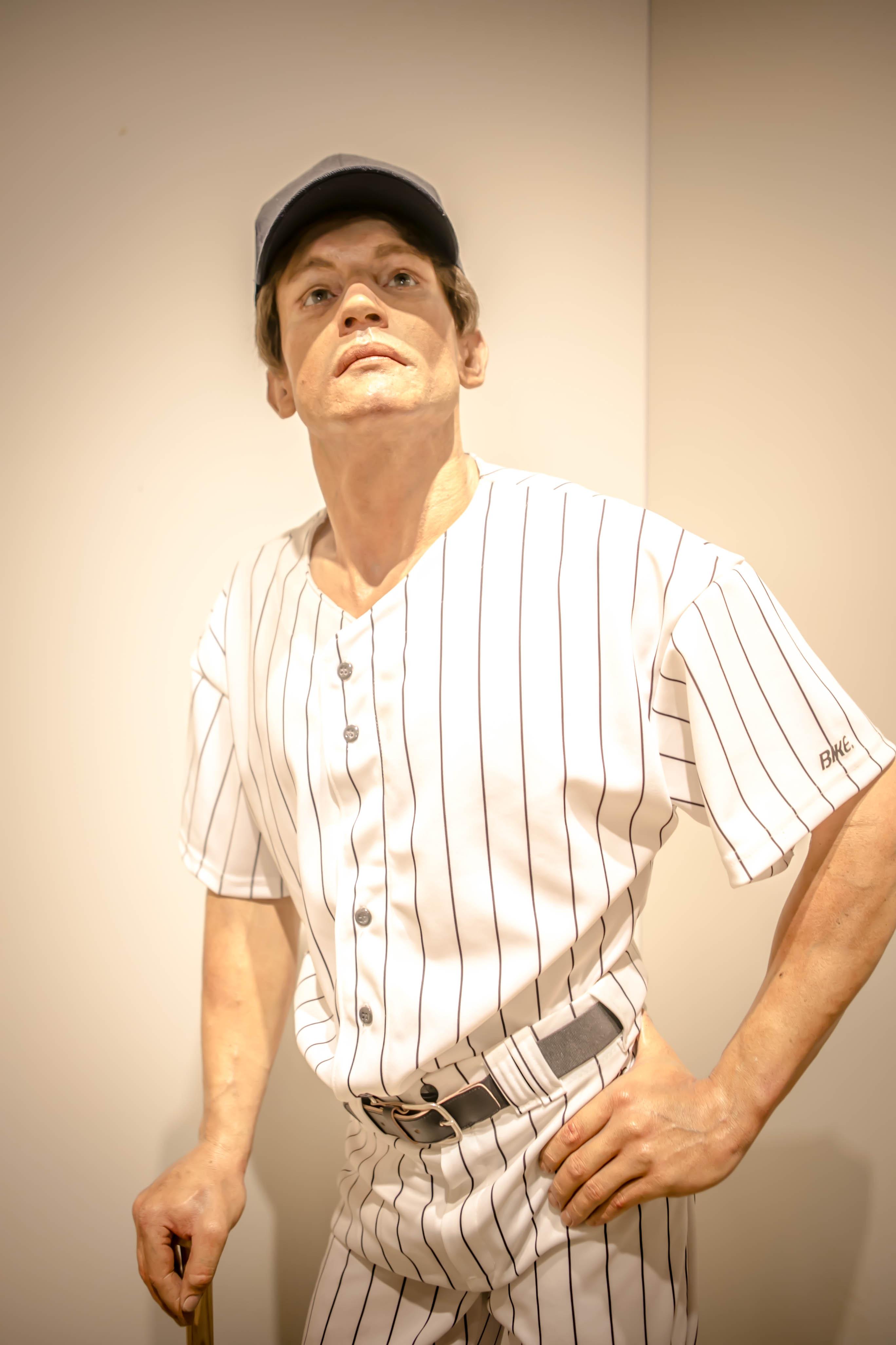 lifelike sculpture of baseball player