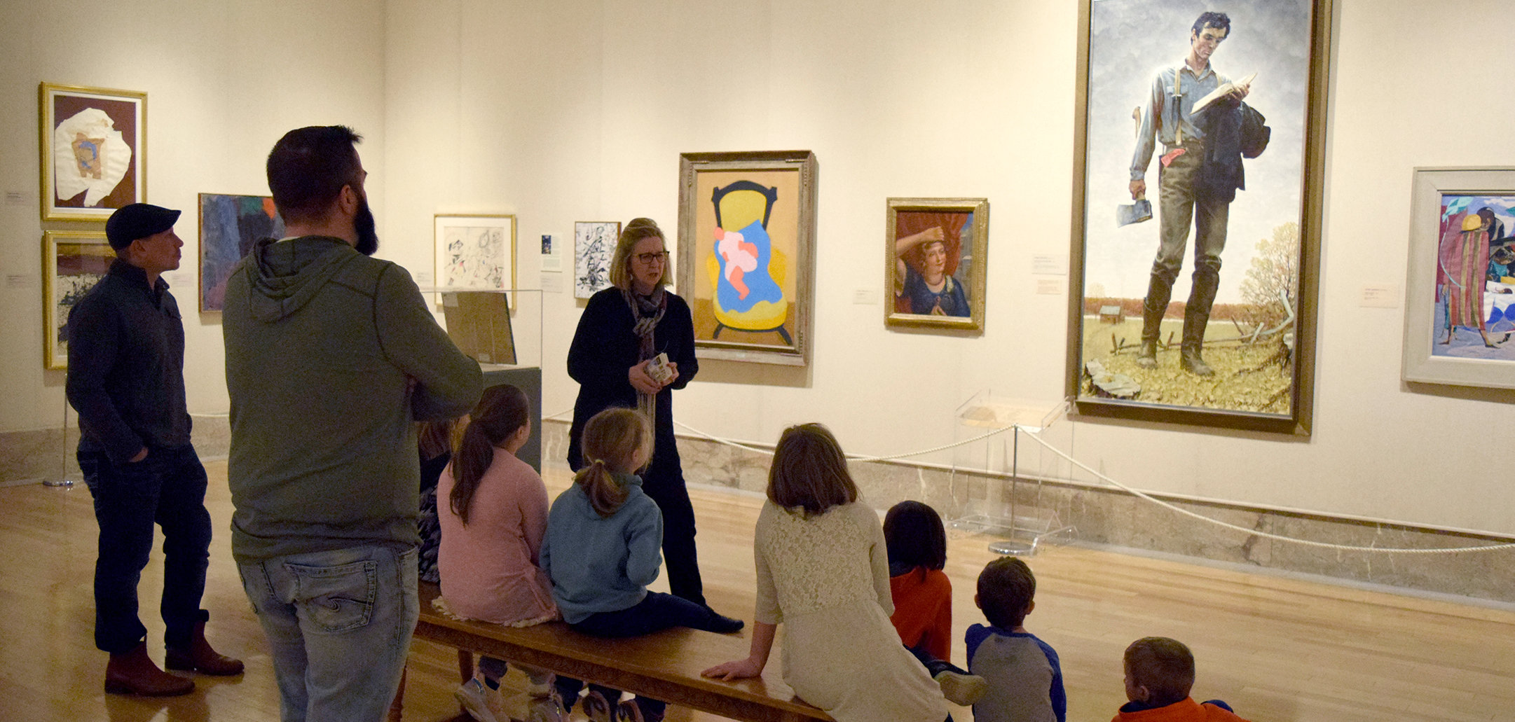 docent speaking to group of children in front of rockwell painting