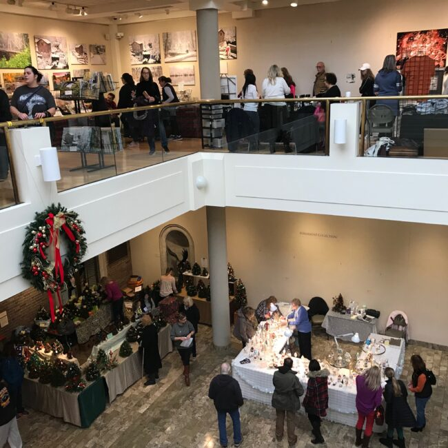 people viewing vendor stations at the craft show