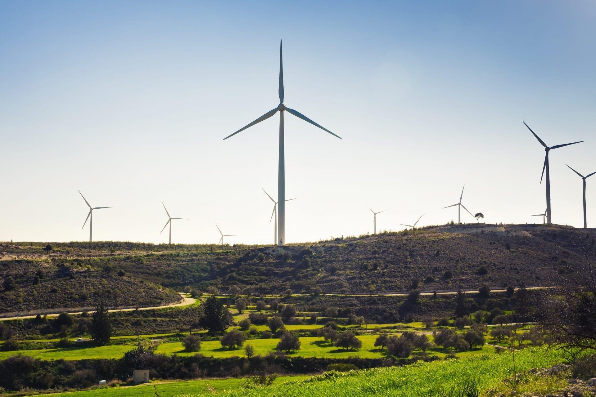 green-meadow-with-wind-turbines-generating-PS79W2B-min