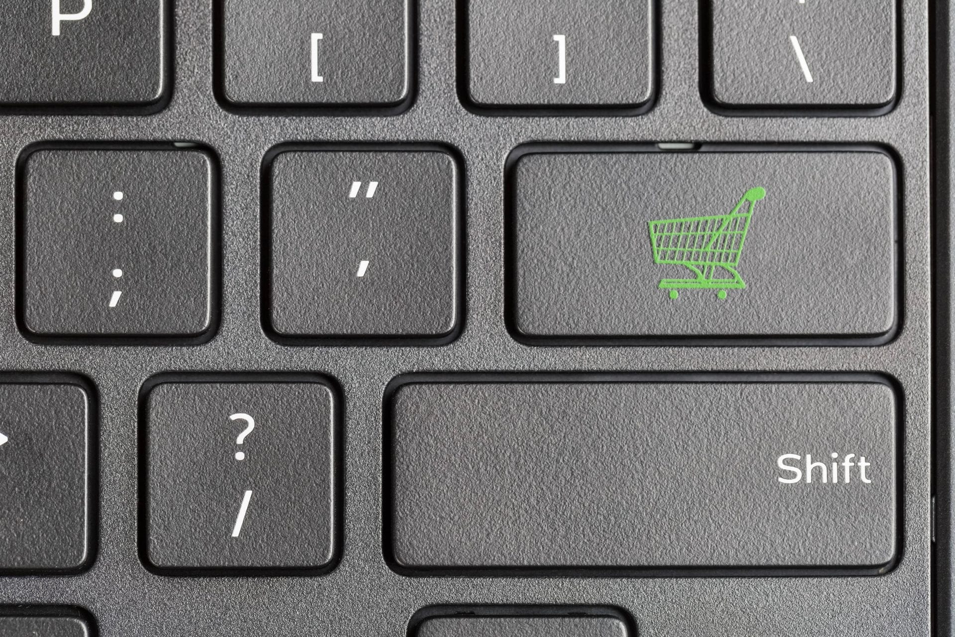 shopping-cart-icon-on-computer-keyboard-PKRKWB6-min