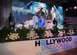 Hollywood Unlocked Social Impact Brunch Awards Stage Setup With LCD and Flowers