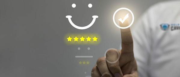 Man digitally selecting customer satisfaction rating