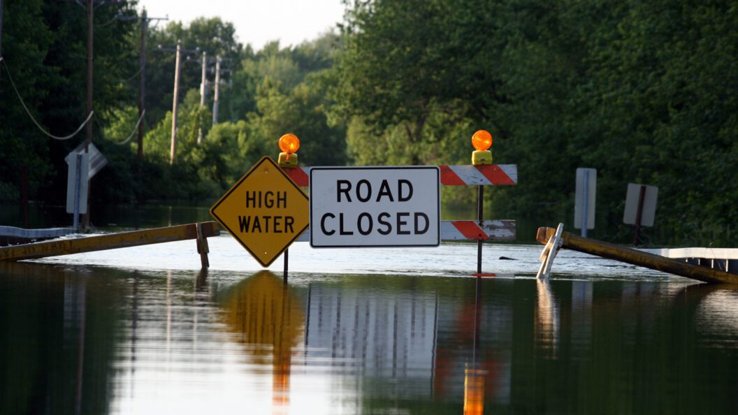 Picture: Flooded Road with High Water and Road Closed Sign