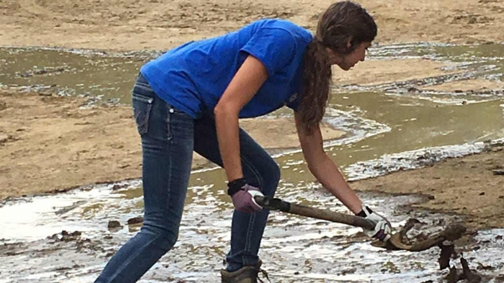 Photo: Service Pump's data scientist, Skye, shoveling mud as part of the cleanup following the 2016 floods in West Virginia.