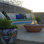 Fire bowl and seat bench on flagstone patio