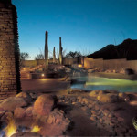 Rock fire pit with gas flame and boulders for seating | 2004 ALCA Award of Excellence