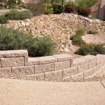 Allan block retaining wall at colored exposed aggregate concrete driveway | 2008 ALCA Judges Award