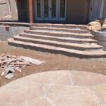 """After removing old """"Arrow Shaped"""" Stairs installed Raised Planters framing a new set of stairs."""