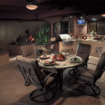 Outdoor kitchen and dining area with colored stamped concrete | 2007 APLD Gold Award