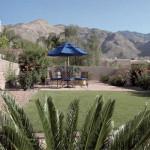 Colored exposed aggregate concrete patio and lawn with brick border   2008 ALCA Judges Award