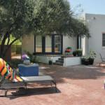 Brick Patio with colorful masonry pot platform   2003 ALCA Judges Award