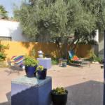 Brick Patio with colorful pot platforms and patio walls | 2003 ALCA Judges Award