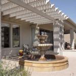 Allumawood shade ramada at colored exposed aggregate concrete patio | 2004 ALCA Judges Award
