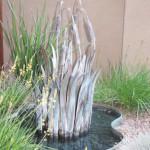 Copper cattail fountain with copper basin