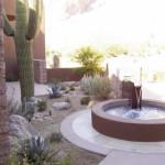 Custom fountain with tiled masonry basin and xeriscape plantings