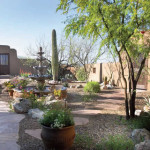 Mexican fountain flagstone path and low maintenance plantings
