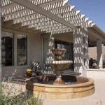 Mexican fountain on colored concrete patio with shade ramada   2004 ALCA Judges Award