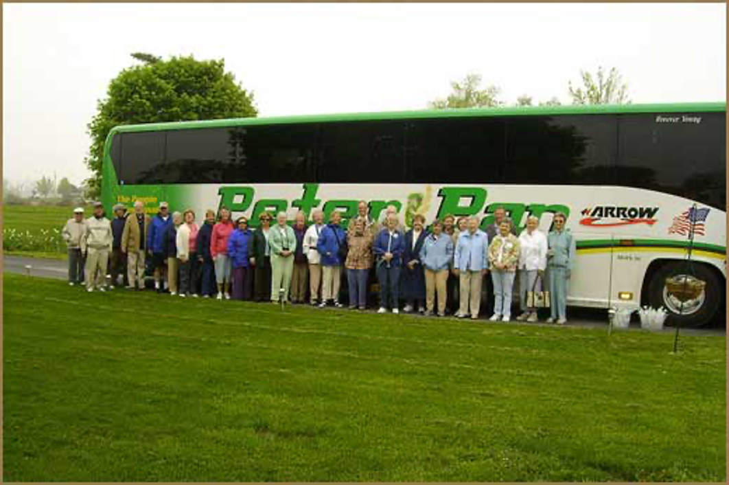 Crowd of people in front of a tour bus parked at Annville Inn. They are on a multistate Garden Tour.