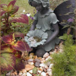 The Fairy fountain sculpture at Butterfly Garden entrance.