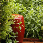 Garden Drum--a large red colored pottery piece in the mint corner of the Garden of the Hidden Orange Rose