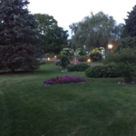 Lovely landscaped gardens at entrance to Annville Inn shown at dusk