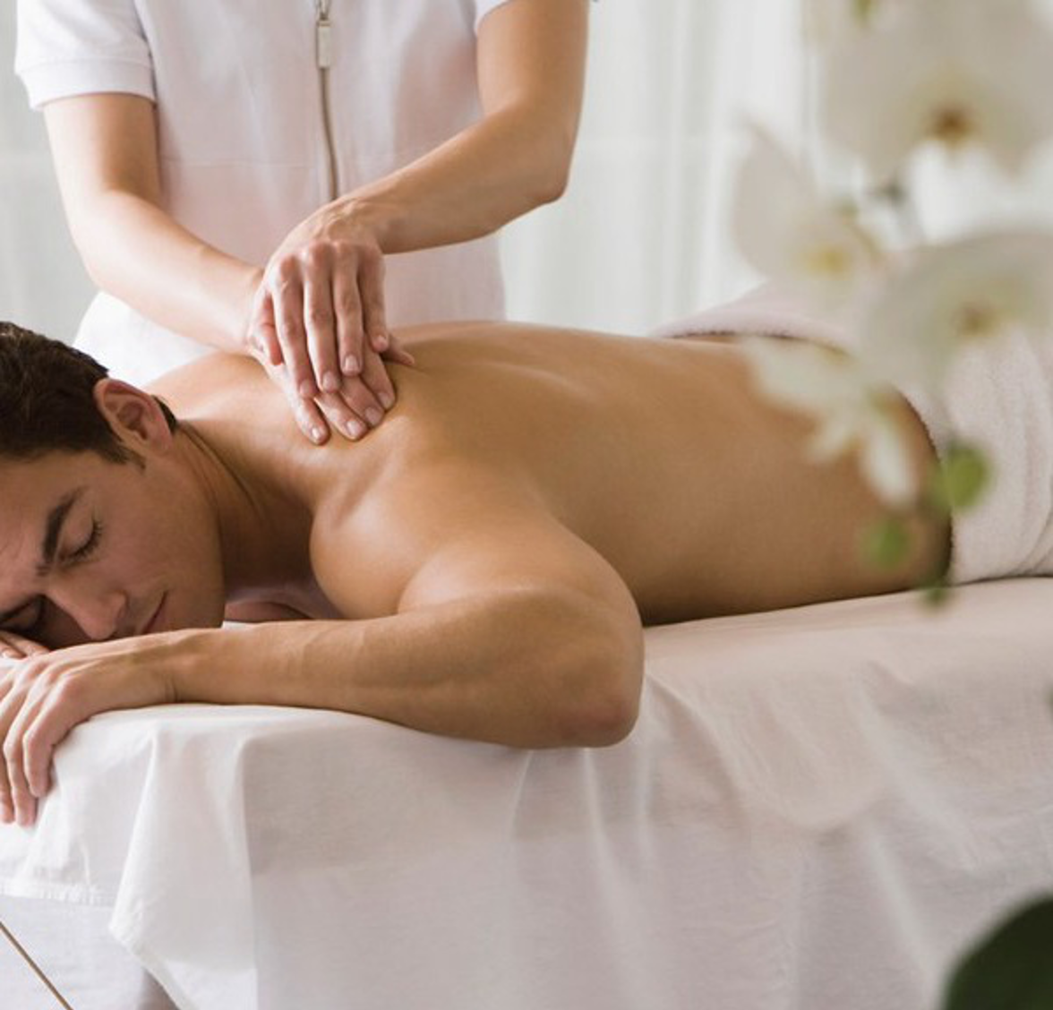 Young Man receiving massage in spa.