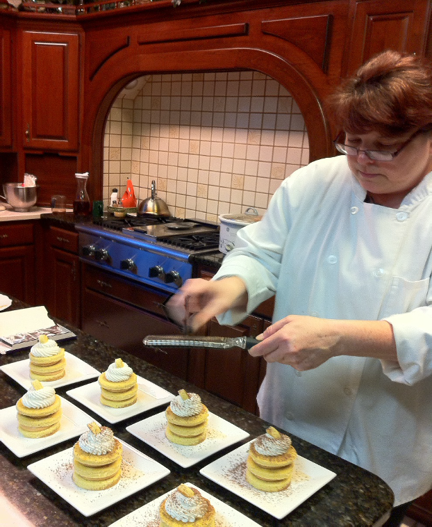 Chef puts finishing touch on desserts at Acclaimed Chef Cooking Class.