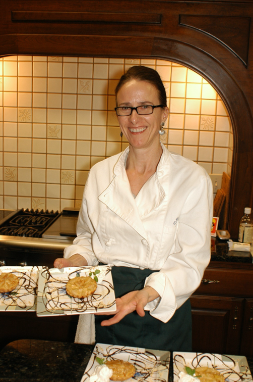 French Chef shows off one of her dishes during Acclaimed Chef Cooking Class