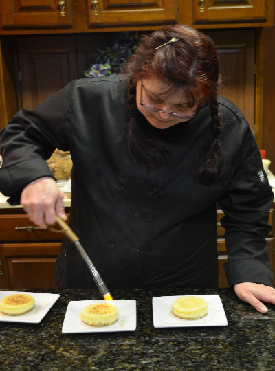Chef Lisa with blow torch on creme brule