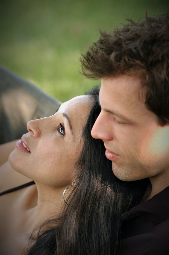 Closeup of young couple, professional outdoor portrait.