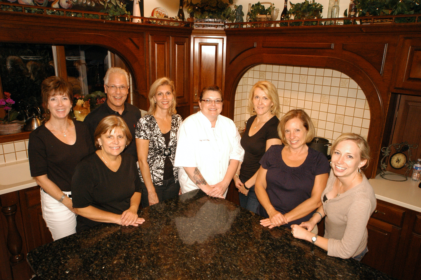 Chef in Ananville Inn kitchen surrounded by seven students for one of Annville Inn's Acclaimed Chef Cooking Classes