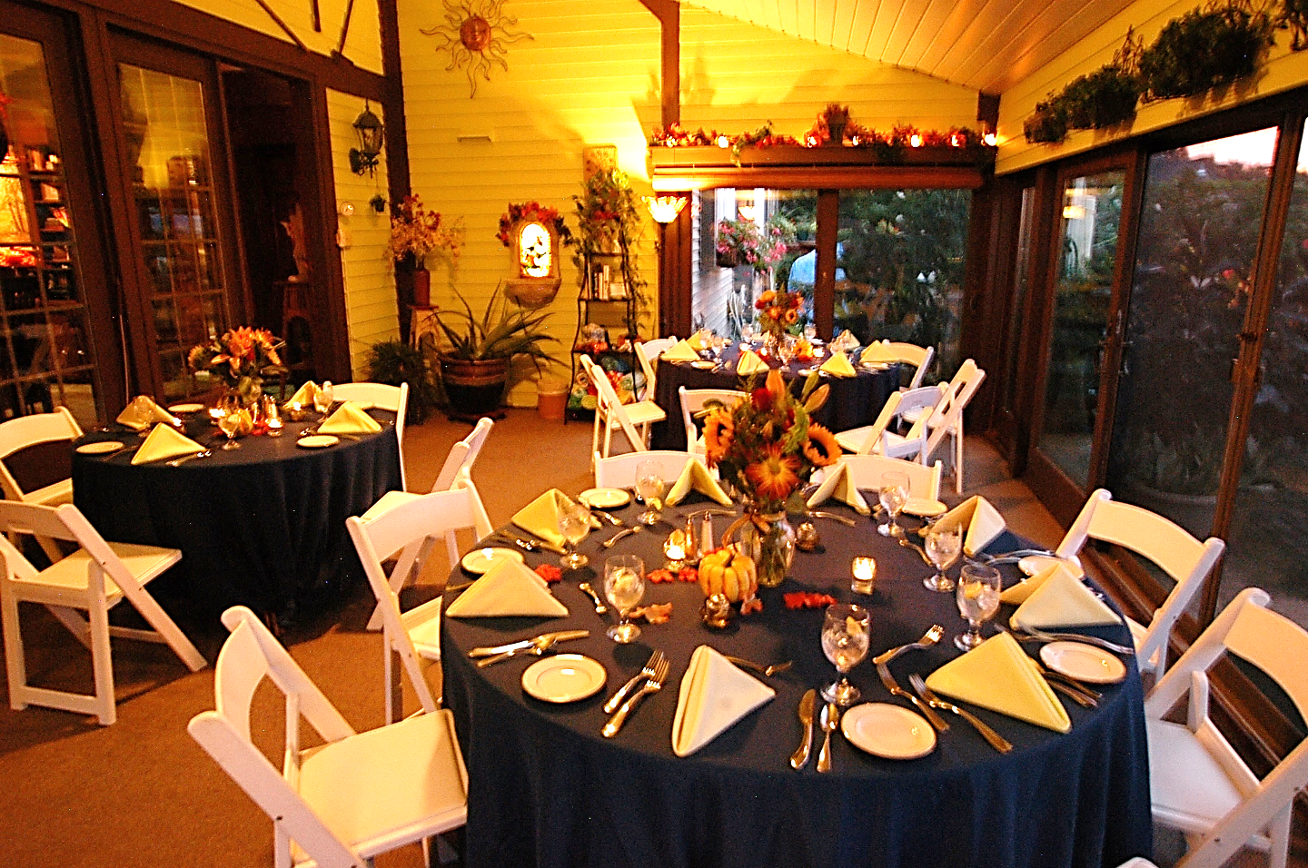 Annville Inn's Garden Room reset to have three round tables set up with eight place settings each for a catered dinner during a reunion.