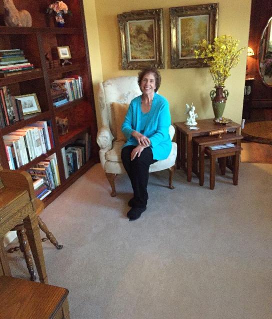 Rosalie George, Innkeeper sitting in Parlor